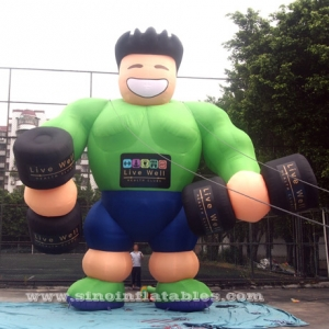 hombre musculoso inflable gigante verde fitness
